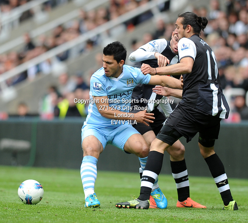 06/05/2012 - Barclays Premier League Football - 2011-2012 - Newcastle United v Manchester City - City's Sergio Aguero looks to break away from the Newcastle defence. - Photo: Charlie Crowhurst / Offside.