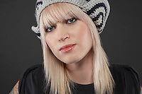 Young woman wearing cap portrait close-up
