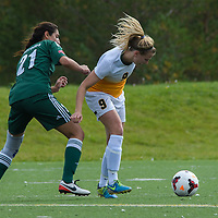 3rd year midfielder Nikita Senko (9) of the Regina Cougars  try to hold off midfielder Sunayna Samra (21) of the Fraser Valley Cascades during the Women's Soccer Homeopener on September 10 at U of R Field. Credit: Arthur Ward/Arthur Images