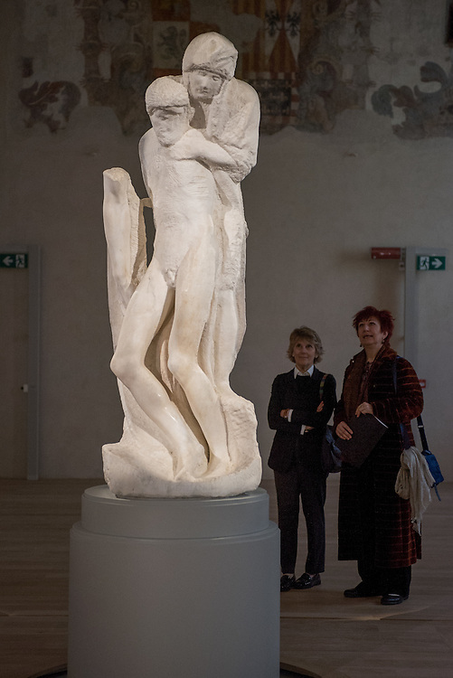 Milan, Italy - 17 April 2015: visitors look up at Michelangelo's Pietà Rondanini at the new museum at the newly restored Ospedale Spagnolo of Castello Sforzesco