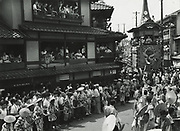 Asano Kiichi<br /> 1914 - 1993<br /> <br /> Kyoto's Gion Festival, 1950s<br /> <br /> Vintage gelatin silver print with blue studio stamp and Asano's red hanko stamp on the reverse.<br /> <br /> Size 6 1/2 in. x 4 3/4 in. (165 mm x 120 mm).<br /> <br /> Condition very good<br /> <br /> Price ¥90,000<br /> <br /> <br /> <br /> <br /> <br /> <br /> <br /> <br /> <br /> <br /> <br /> <br /> <br /> <br /> <br /> <br /> <br /> <br /> <br /> <br /> <br /> <br /> <br /> <br /> <br /> <br /> .