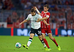 MUNICH, GERMANY - Tuesday, August 1, 2017: Liverpool's Jon Flanagan and Bayern Munich's Thomas Mueller during the Audi Cup 2017 match between FC Bayern Munich and Liverpool FC at the Allianz Arena. (Pic by David Rawcliffe/Propaganda)