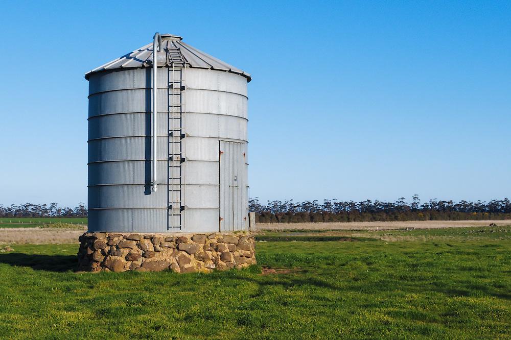 Grain silo in farm paddock in rural country Victoria, Australia.