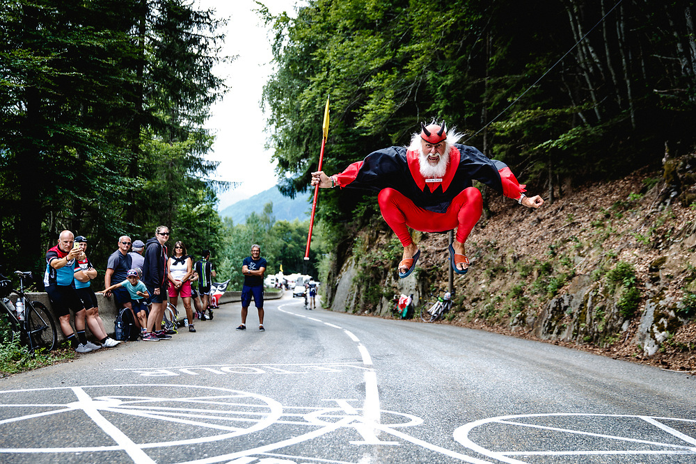 Not much else says the Tour de France has arrived in the Hautes Alpes like seeing Didi the Devil entertaining passersby along the race course. Photo: Iri Greco / BrakeThrough Media | www.brakethroughmedia.com