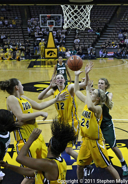 January 27 2010: Iowa guard Jaime Printy (24) grabs a rebound during the first half of an NCAA women's college basketball game at Carver-Hawkeye Arena in Iowa City, Iowa on January 27, 2010. Iowa defeated Michigan State 66-64.