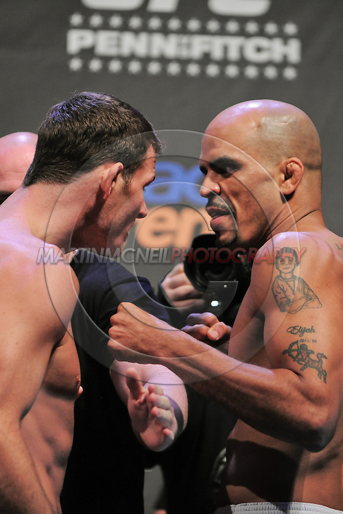 """SYDNEY, AUSTRALIA, FEBRUARY 26, 2011: Michael Bisping (left) faces off against opponent Jorge Rivera during the weigh-in for """"UFC 127: Penn vs. Fitch"""" inside Acer Arena in Sydney, Australia on February 26, 2011"""