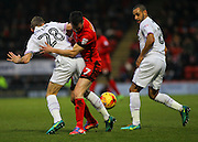 Michael Collins attempts to dispossess Jack Taylor during the EFL Sky Bet League 2 match between Leyton Orient and Barnet at the Matchroom Stadium, London, England on 7 January 2017. Photo by Jack Beard.