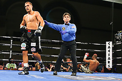 Atlantic City, New Jersey, USA - March 29, 2014: Sergei Kovalev (black w/ silver trunks) and Cedric Agnew (black w/ gold trunks) during their 12 round WBO Light Heavyweight title bout at the Adrian Phillips Ballroom in Atlantic City, NJ.  Photo: Ed Mulholland/HBO