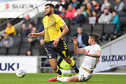 Coventry City forward  Max Biamou (9) is fouled by Milton Keynes Dons midfielder Jordan Houghton (24) during the EFL Sky Bet League 1 match between Milton Keynes Dons and Coventry City at stadium:mk, Milton Keynes, England on 19 October 2019.