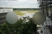 A parked British Airways aircraft is seen through the window at departures level at Heathrow airport's Terminal 5.