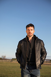 handsome man in a leather jacket outdoors