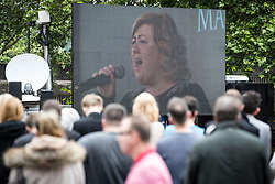 © Licensed to London News Pictures . 30/06/2017 . Stockport , UK . Crowds in the street outside the Town Hall watch the service and Michelle McManus singing , on a big screen . The funeral of Martyn Hett at Stockport Town Hall . Martyn Hett was 29 years old when he was one of 22 people killed on 22 May 2017 in a murderous terrorist bombing committed by Salman Abedi, after an Ariana Grande concert at the Manchester Arena . Photo credit : Joel Goodman/LNP