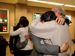 A man arriving from Tripoli on an evacuation flight tearfully hugs a relative welcoming him at Malta International Airport outside Valletta February 23, 2011. .Photo by Darrin Zammit Lupi