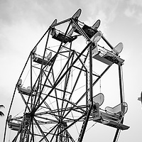 Newport Beach California Balboa Fun Zone Ferris Wheel and toy soldier black and white photo.  The Ferris Wheel has been a popular attraction in the Balboa Fun Zone since 1936. Newport Beach is a coastal city along the Pacific Ocean in beautiful Orange County Southern California. Copyright ⓒ 2017 Paul Velgos with All Rights Reserved.