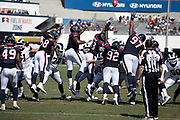 The Houston Texans defense leaps while trying to block an extra point during the 2018 NFL preseason week 3 football game against the Los Angeles Rams on Saturday, Aug. 25, 2018 in Los Angeles. The Rams won the game 21-20. (©Paul Anthony Spinelli)