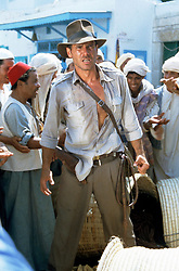 RELEASE DATE: June 12, 1981<br /> MOVIE TITLE: Raiders of the Lost Ark<br /> STUDIO: Paramount Pictures<br /> DIRECTOR: Steven Spielberg<br /> PLOT: The year is 1936. A professor who studies archeology named Indiana Jones is venturing in the jungles in South America searching for a golden statue. Unfortunately, he sets off a deadly trap doing so, miraculously, he escapes<br /> PICTURED: HARRISON FORD as Indiana Jones<br /> (Credit Image: © Paramount Pictures/Entertainment Pictures/ZUMAPRESS.com)