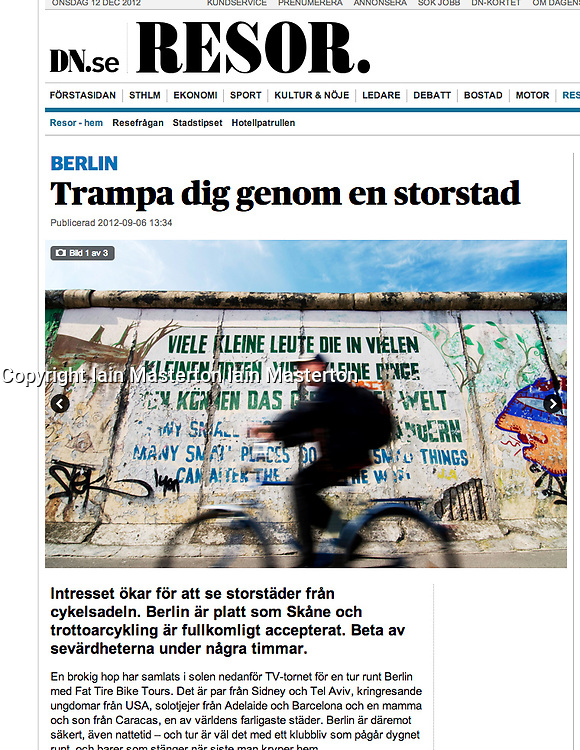 DN.se newspaper; Cyclist and Berlin Wall travel article