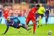 Bayern Munich midfielder Alphonso Davies (19) tussles with Tottenham Hotspur midfielder Lucas Moura (27) during the Champions League match between Bayern Munich and Tottenham Hotspur at Allianz Arena, Munich, Germany on 11 December 2019.