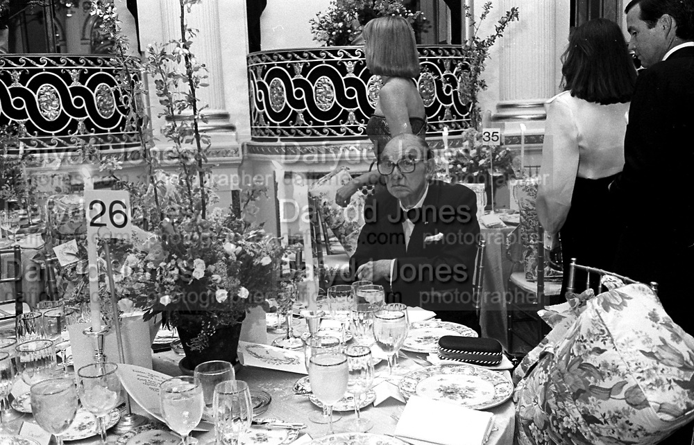 Milton Petrie sitting  at a benefit for the Boys Club of New York. Spring Dance. Plaza hotel. New York. 26 April 1990.  © Copyright Photograph by Dafydd Jones 66 Stockwell Park Rd. London SW9 0DA Tel 020 7733 0108 www.dafjones.com