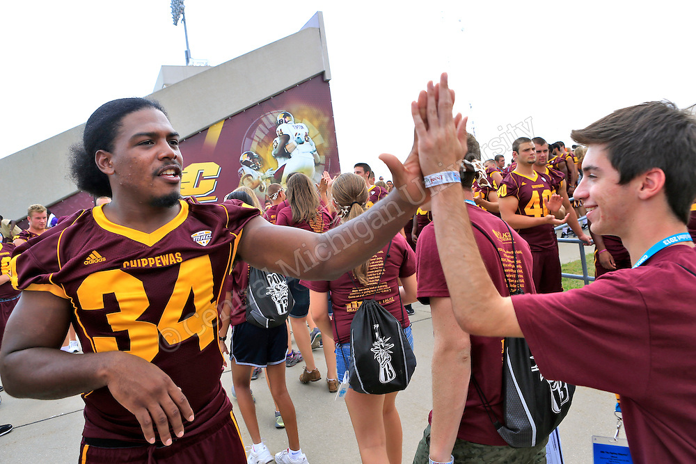 Chippewa running back Zurlon Tipton greets students. Leadership Safari held it's traditions day in Kelly/Shorts Stadium on the Central Michigan University campus Wednesday. Safari students filled some sections of the stands on the west side and were introduced to CMU sports teams, coaches, the marching band. They also learned various cheers and how important they were to the success of the teams. Photo by Steve Jessmore/Central Michigan University