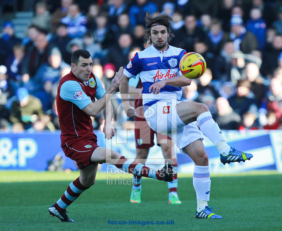 Picture by John Rainford/Focus Images Ltd +44 7506 538356<br /> 01/02/2014<br /> Niko Kranjcar of Queens Park Rangers and Dean Marney of Burnley during the Sky Bet Championship match at the Loftus Road Stadium, London.