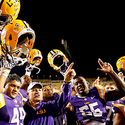 Oct 26, 2013; Baton Rouge, LA, USA; LSU Tigers head coach Les Miles celebrates with his players following a win over the Furman Paladins in a game at Tiger Stadium. LSU defeated Furman 48-16. Mandatory Credit: Derick E. Hingle-USA TODAY Sports