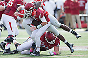 LITTLE ROCK, AR - OCTOBER 18:  Brandon Allen #10 of the Arkansas Razorbacks is hit after throwing a pass by Ray Drew #47 of the Georgia Bulldogs at War Memorial Stadium on October 18, 2014 in Little Rock, Arkansas.  The Bulldogs defeated the Razorbacks 45-32.  (Photo by Wesley Hitt/Getty Images) *** Local Caption *** Brandon Allen; Ray Drew
