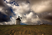 Lanzarote volcanic  Canary Island , Spain on Atlantic Ocean in January Photo Piotr Gesicki Furteventura Canary Island on Atlantic Ocean ( Spain ) Traditional 600 years old Wind mill Photo Piotr Gesicki