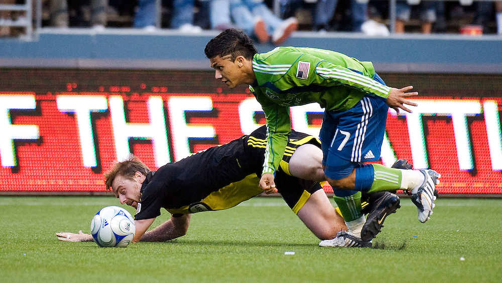 SEATTLE - MAY 30:  Seattle's Fredy Montero gets past Columbus midfielder Eddie Gaven during their match at Qwest Field on May 30, 2009 in Seattle, Washington.  (Photo by Rod Mar/MLS via Getty Images)
