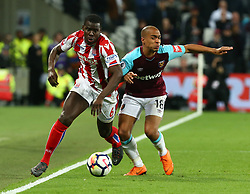 April 16, 2018 - London, England, United Kingdom - Stoke City's Kurt Zouma takes on West Ham United's  Joao Mario .during English Premier League match between West Ham United and Stoke City at London stadium, London, England on 16 April 2018. (Credit Image: © Kieran Galvin/NurPhoto via ZUMA Press)