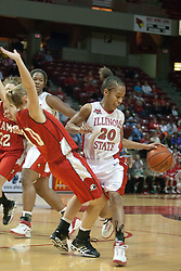 09 December 2006: Tiffany Hudson brushes past Jenna Schone. In a non-conference game, the Redhawks of Miami (Ohio) were defeated by the Redbirds at Redbird Arena in Normal Illinois on the campus of Illinois State University.<br />