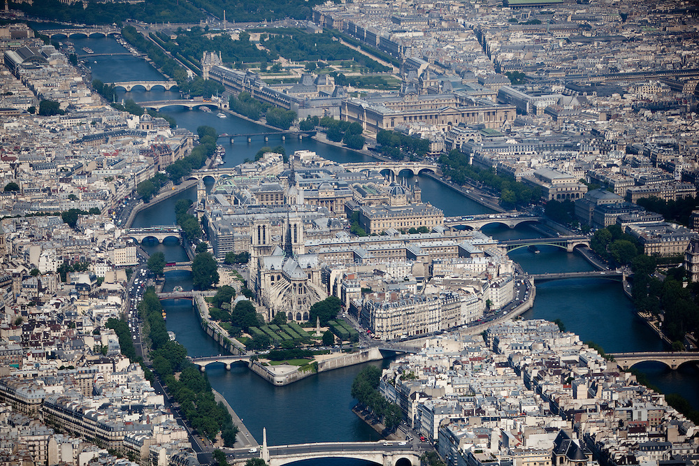 The Île de la Cité is one of two remaining natural islands in the Seine within the city of Paris. It is the centre of Paris and the location where the medieval city was refounded. In addition, it's where the Nore-Dame cathedral is located.