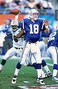 MIAMI GARDENS, FL - DECEMBER 30: Peyton Manning #18 of the Indianapolis Colts passes the football during the AFC Wild Card playoff game against the Miami Dolphins at Pro Player Stadium on December 30, 2000 in Miami Gardens, Florida. The Dolphins defeated the Colts 23-17 in overtime. (Photo by Joe Robbins) *** Local Caption *** Peyton Manning