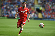 Aron Gunnarsson of Cardiff city in action .Skybet football league championship match, Cardiff city v Norwich city at the Cardiff city Stadium in Cardiff, South Wales on Saturday 13th Sept 2014<br /> pic by Andrew Orchard, Andrew Orchard sports photography.