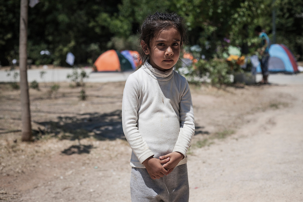 Greece, Athens, July 25th 2015 - Portrait of an Afghan girl at Pedion tou Areos park where hundreds of migrants and refugees mostly from Afghanistan have build a temporary camp, after they arrived in Athens from the Greek islands wishing to continue their journey to central Europe.