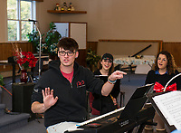 "Patrick Dorow works through the melodies during rehearsal with his cast for the upcoming Christmas music extravaganza ""Home for the Holidays"" to be presented by Interlakes Theater at the Flying Monkey on December 15th-16th.  (Karen Bobotas/for the Laconia Daily Sun)"