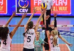 04-01-2016 TUR: European Olympic Qualification Tournament Nederland - Duitsland, Ankara <br /> De Nederlandse volleybalvrouwen hebben de eerste wedstrijd van het olympisch kwalificatietoernooi in Ankara niet kunnen winnen. Duitsland was met 3-2 te sterk (28-26, 22-25, 22-25, 25-20, 11-15) / Heike Beier #12 of Germany, Celeste Plak #4, Robin de Kruijf #5, Laura Dijkema #14