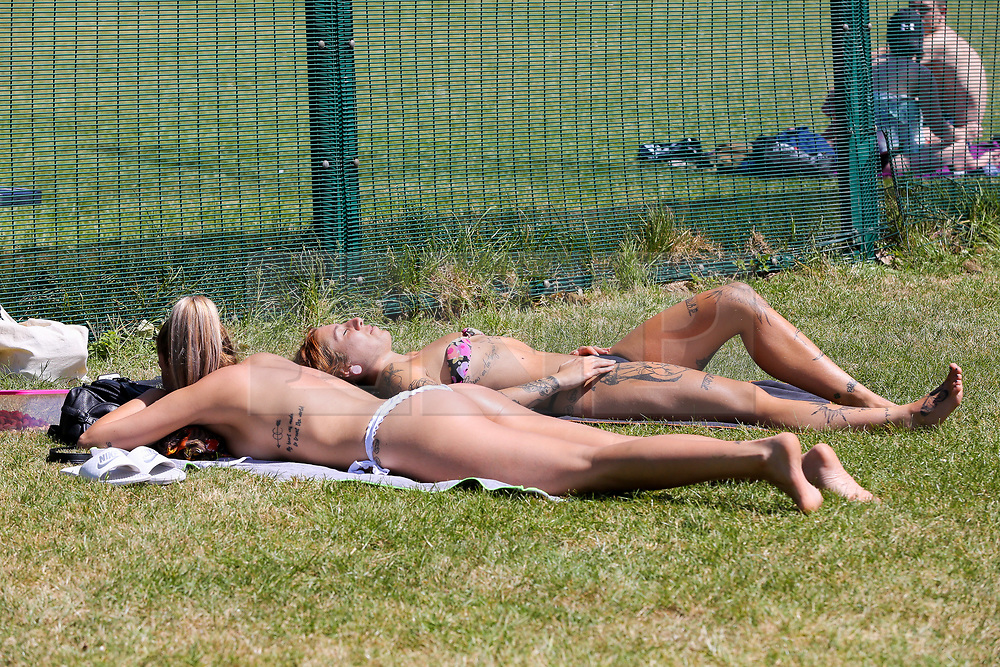 © Licensed to London News Pictures. 25/05/2020. London, UK. Women sunbathing in Finsbury Park, north London on a warm and sunny Bank Holiday. The government has relaxed the rules during the COVID-19 lockdown, allowing people to spend more time outside to enjoy sunbathing and picnicking whilst following social distancing guidelines. According to the Met Office, warmer temperatures are forecast with highs of 25 degrees celsius.  <br /> <br /> ***Permission Granted***<br /> <br /> Photo credit: Dinendra Haria/LNP