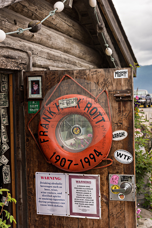 Famous Salty Dawg Saloon in the original log cabin built in 1897 along the marsh boardwalk on Homer Spit on Kamishak Bay in Homer, Alaska.