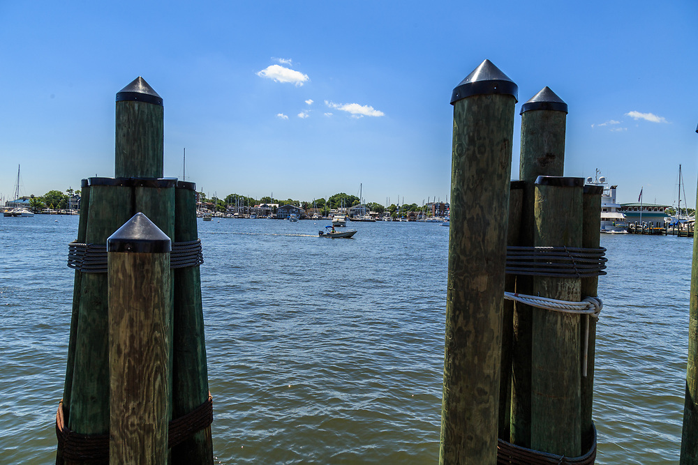 Annapolis, MD / USA - July 9, 2017: A pier and dock at the harbor near the downtown area of Maryland's capital city.