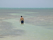 Man walking in to the ocean Florida Keys