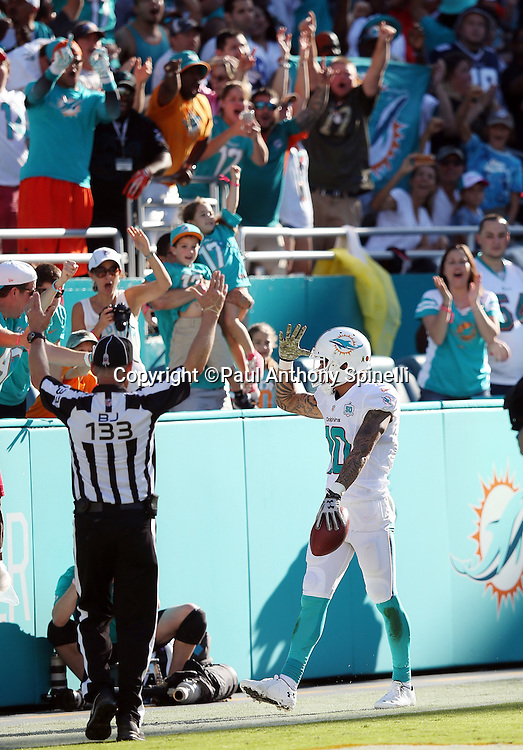 Miami Dolphins wide receiver Kenny Stills (10) waves at fans after catching a 29 yard touchdown pass that ties the third quarter score at 14-14 during the 2015 week 11 regular season NFL football game against the Dallas Cowboys on Sunday, Nov. 22, 2015 in Miami Gardens, Fla. The Cowboys won the game 24-14. (©Paul Anthony Spinelli)
