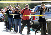 Oct 1, 2015 - Roseburg, Oregon, U.S. - <br /> <br /> Students, staff and faculty are evacuated from Umpqua Community College after a deadly shooting Thursday. As many as 10 people were killed and 20 injured when a shooter opened fire at Oregon's Umpqua Community College on Thursday. <br /> ©Exclusivepix Media