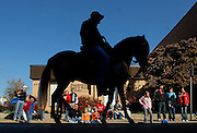 "A horse and rider from the Equestrian Club of Southeast Missouri is silhouetted against a line of parade-watchers during Southeast Missouri State University's Homecoming Parade on Saturday, Oct. 30, 2010, in Cape Girardeau. This year's theme was ""Toon into Southeast."""