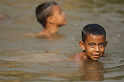 Children swim in a river in San Esteban, Honduras on Thursday April 25, 2013.