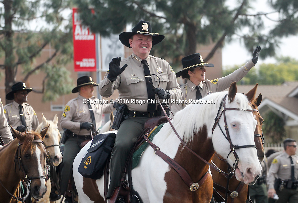 Los Angeles County Sheriff Jim McDonnell joins deputy's on horseback as the Martin Luther King Jr. parade makes it's way down Martin Luther King Blvd. in Los Angeles on Monday Jan. 18, 2016. The 31st annual Kingdom Day Parade honoring Martin Luther King Jr. was themed &quot;Our Work Is Not Yet Done&quot;(Photo by Ringo Chiu/PHOTOFORMULA.com)<br /> <br /> Usage Notes: This content is intended for editorial use only. For other uses, additional clearances may be required.