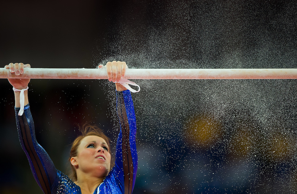Vanessa Ferrari of Italy chalked the bar prior to her performance in the uneven bars apparatus in the women's team preliminaries competition at North Greenwich Arena during the 2012 Summer Olympic Games in London, England, Sunday, July 29, 2012. (David Eulitt/Kansas City Star/MCT)