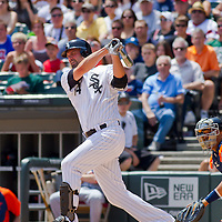 Chicago, IL - June 05, 2011:  Chicago White Sox player, Paul Konerko (14) bats against the Detroit Tigers at U.S. Cellular Field on June 5, 2011 in Chicago, IL.