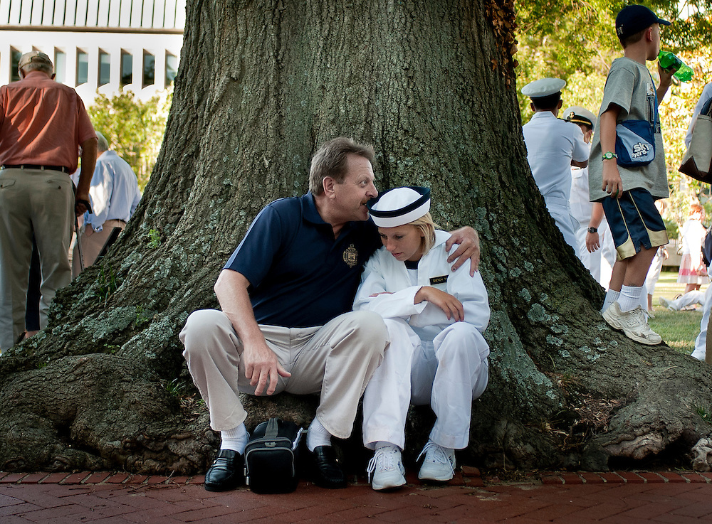 "A father and daugher share a quiet moment following her taking the oath of office at the U.S. Naval Academy in Annapolis, MD. Approximately 1,230 young men and women arrived at the U.S. Naval Academy's Alumni Hall, Thursday, July 1, for Induction Day to begin their new lives as ""plebes"" or midshipmen fourth class (freshmen). ""I-Day"" culminates when the members of the Class of 2014 take the oath of office at a ceremony at 6 p.m. in Tecumseh Court, the historic courtyard of the Bancroft Hall dormitory. Over 17,400 young men and women applied to be members of the Naval Academy Class of 2014 - a record for USNA."