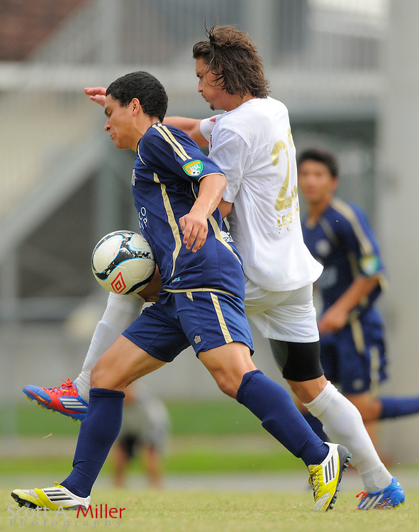 Orlando City forward Drew Helm (23) and Austin Aztex midfielder Jesus Cortes (15) fight for a ball during City's 4-1 win over the Aztex in the PDL Southern Conference Championships final at Trinity Catholic High Schooll on July 22, 2012 in Ocala, Florida. ..©2012 Emily A. Miller